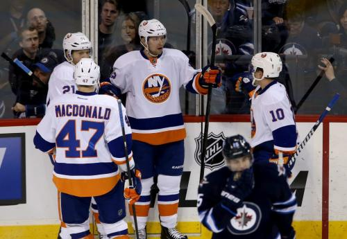 The New York Islanders' celebrate after Josh Bailey (12), middle, scored the Islanders' second goal of the period to retake the lead against the Winnipeg Jets' during first period NHL action at MTS Centre in Winnipeg, Saturday, April 20, 2013. (TREVOR HAGAN/WINNIPEG FREE PRESS)