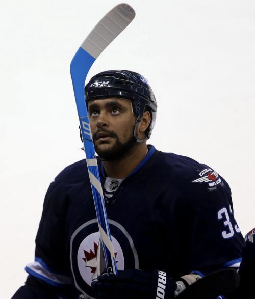 Winnipeg Jets' Dustin Byfuglien (33) examines a new stick during first period NHL action against the New York Islanders' at MTS Centre in Winnipeg, Saturday, April 20, 2013. (TREVOR HAGAN/WINNIPEG FREE PRESS)