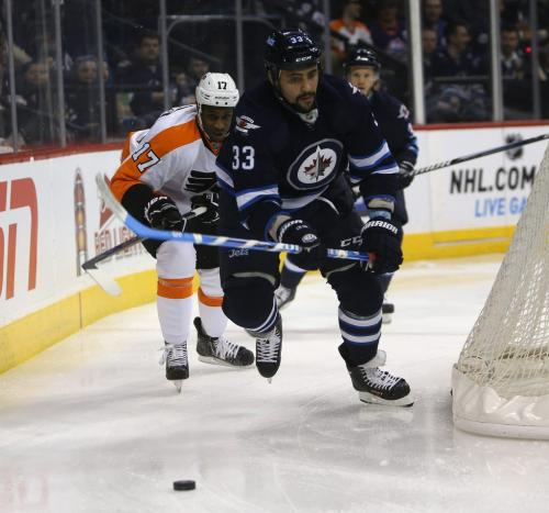 Winnipeg Jets' Dustin Byfuglien (33) is chased by Philadelphia Flyers Wayne Simmonds (17) during the first period at MTS Centre in Winnipeg, Saturday, April 6, 2013. (TREVOR HAGAN/WINNIPEG FREE PRESS)
