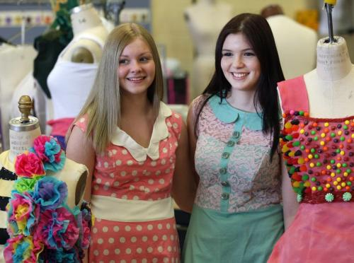 """Kids from Murdoch MacKay Collegiate Fashion Technology and Design are preparing for their """" Now in Full Colour"""" fashion show- Students Kaylee Driver, left and her pink polka dot dress, and Rayanne Boittiaux with her Green and pink dress–See Connie Tamoto fashion story -April 23, 2013   (JOE BRYKSA / WINNIPEG FREE PRESS)"""