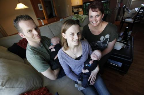May 6, 2013 - 130506  - In their home Monday, May 6, 2013 husband and wife Mike Olson (L) and Lisa Seel (C) holding their sons Keenan and Kai respectively are photographed with Lisa's sister Averill Stephenson who was a surrogate for them. The province recognizes Stephenson and her husband as the parents and not Mike and Lisa. John Woods / Winnipeg Free Press