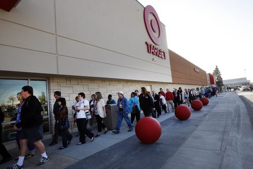 Several hundred  people were in line at 8am for the opening - (not in pic) -First in line since 7am is Nancy Matthews , Tamara Gunn Gwenyth Kirkness  age 13 and Keara Gunn age 11 – one of three stores opening in Manitoba today Winnipeg Target store at  Kildonan Place Target opened at  8am with soft opening  of the 129,000 sq ft store ( 75,000 sq ft sales floor) KEN GIGLIOTTI / May 7  2013 / WINNIPEG FREE PRESS