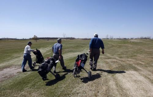 Golfer head off  on a dry windy day - City of Winnipeg is putting the John Blumberg Park  ,golf , softball and  soccer complex   up for sale -  KEN GIGLIOTTI / May 13  2013 / WINNIPEG FREE PRESS