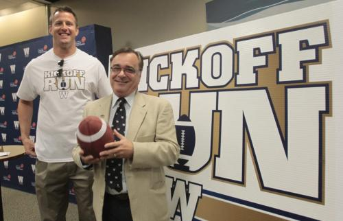 At right, Jerry Maslowsky with the Winnipeg Blue Bombers and former Bomber player Doug Brown who is the Ambassador for the Kickoff Run relay June 22-June 27 that was  announced Tuesday at Great West Life Conference Centre. The relay will consist of 400 runners from across the province that will be chosen or has won the chance to take part passing a CFL football in relay fashion on a route through several locations including,  Brandon,Winkler, Gimli and Selkirk. The relay will also pass by former historical locations like the Osborne Stadium, Canad Inns Stadium then arriving at the Investors Group Field on June 27th Opening Ceremonies. see release.     (WAYNE GLOWACKI/WINNIPEG FREE PRESS) Winnipeg Free Press May 14 2013