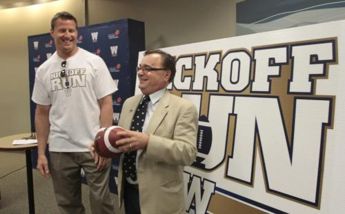 At right, Jerry Maslowsky with the Winnipeg Blue Bombers and former Bomber player Doug Brown who is the Ambassador for the Kickoff Run relay June 22-June 27 that was  announced Tuesday at Great West Life Conference Centre. The relay will consist of 400 runners from across the province will be chosen or has won the chance to take part passing a CFL football in relay fashion on a route through several locations including, Winkler, Selkirk, Brandon and Gimli. The relay will also pass by former historical locations like the Osborne Stadium, Canad Inns Stadium then arriving at the Investors Group Field on June 27th Opening Ceremonies. see release.     (WAYNE GLOWACKI/WINNIPEG FREE PRESS) Winnipeg Free Press May 14 2013