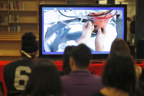 Sisler High School students watch a live knee operation that the Pan Am Clinic was doing today. The students did this via video conference and had access to talk with the doc live during the operation. More than 1200 students from across the provence got access to the first in Canada event. May 30, 2013  BORIS MINKEVICH / WINNIPEG FREE PRESS