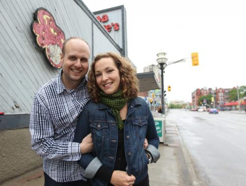 The Grove Restaurant owners Miles and Danielle Gould  pose for a photo outside the old Papa George's Restaurant on the corner of River and Osborne Wednesday afternoon just before press conference announcing the opening of a second restaurant by the couple within the year.  The new restaurant slated to open in October  will be a different name and concept from The Grove but will have the same owners and head chef Norman Pastorin.  May 30, 2013 Ruth Bonneville Winnipeg Free Press