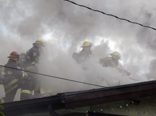 Fire crews battle heavy smoke  on roof of single story home on fire-House fire , bungalow at  Foxdale ave and the corner of Delbrook Cres. near Rothesay and Chief Peguis Trail , the fire started in the cieling and the entire roof structure is billowing smoke from several holes cut by the fire crews trying to fight the fire  KEN GIGLIOTTI / JUNE 5 2013 / WINNIPEG FREE PRESS