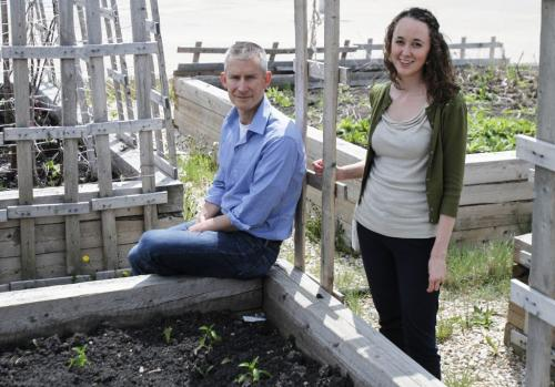 Nick Saul, head of the Community Food Centres Canada, and Kristina McMillan, director of Nor-West Co-op Community Food Centre, check out a small community garden near Gilbert Park on Friday, June 7, 2013. They will be opening up a new healthy food centre in Gilbert Park with a community kitchen and community gardens. Construction is set to begin this summer with a grand opening in January 2014. (GEOFF KIRBYSON) (JESSICA BURTNICK/WINNIPEG FREE PRESS)