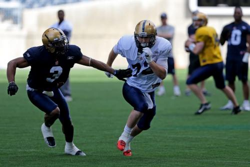 Winnipeg Blue Bombers' Cauchy Muamba (3), tries to hold up Brett Carter (72) while he waits for a pass from QB, Chase Clement (14), right, during practice at Investors Group Field, Saturday, June 8, 2013. (TREVOR HAGAN/WINNIPEG FREE PRESS)