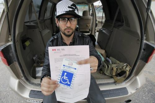 June 9, 2013 - 130609  - Thaddeus Conrad of Steinbach shows his medical marijuana permit and claims he was beaten by police and arrested for possession of marijuana for trafficking. Conrad was photographed in Steinbach Sunday, June 9, 2013. John Woods / Winnipeg Free Press