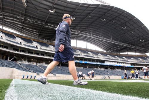 Winnipeg Blue Bombers head coach  Tim Burke enters the field during practice Monday at Investors Group Field- The Winnipeg Blue Bombers will play their first pre season game in the brand new stadium this Wednesday evening against the Toronto Argonauts   -See Tim Campbell and Ed Tait stories- June 10, 2013  (JOE BRYKSA / WINNIPEG FREE PRESS)