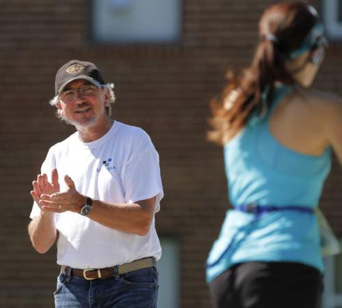 A spectator claps and encourages runners as they reach Mile 18 of the Manitoba Marathon in Winnipeg on Sunday, June 16, 2013. (CAROL SANDERS) (JESSICA BURTNICK/WINNIPEG FREE PRESS)