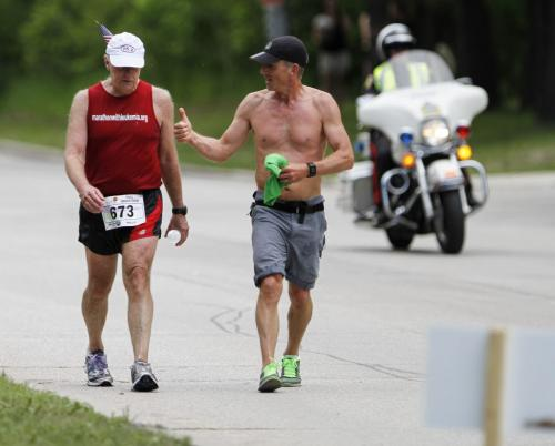 Manitoba Marathon runners push and encourage each other through Mile 24 of the Manitoba Marathon on River Rd. in Winnipeg on Sunday, June 16, 2013. (JESSICA BURTNICK/WINNIPEG FREE PRESS)