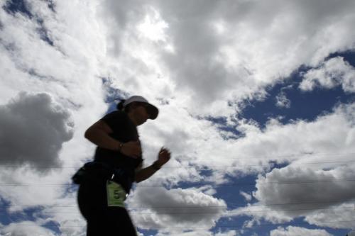 Clouds gather overhead as the last of the Manitoba Marathon runners pass the 24th mile mark on Bishop Grandin in Winnipeg on Sunday, June 16, 2013. (JESSICA BURTNICK/WINNIPEG FREE PRESS)