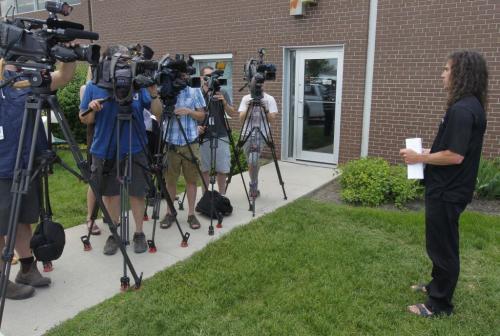 City of Winnipeg entomologist Taz Stuart gives his update to the press in front of 1539 Waverly. BORIS MINKEVICH / WINNIPEG FREE PRESS. June 18, 2013