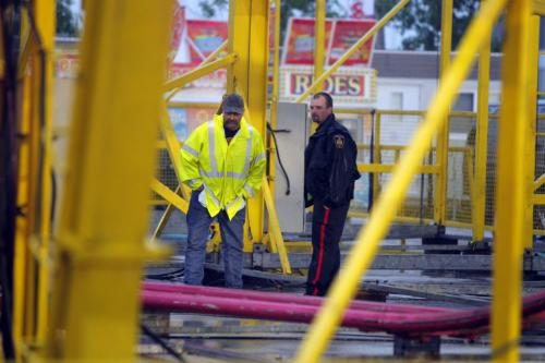 A boy was rushed to hospital after being accidently struck by a ride at the Red River Exhibition early Thursday evening. The accident took place at about 6:15 p.m. A witness to the event said she saw the boy, who she estimated was about 12 years old, run onto the track of the Crazy Mouse roller-coaster after he dropped his hat. He was likely trying to retrieve it, said Uma Jacoby, 13. Uma said one of the Crazy Mouse's cars hit the boy, who was left unconscious and later attended to by paramedics. June 20 2013. BORIS MINKEVICH / WINNIPEG FREE PRESS