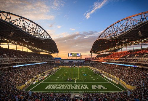 The sun sets during the inaugural game at Investors Group Field in Winnipeg on June 27, 2013. Watch a time-lapse video of the opening of the new Blue Bombers stadium made with over 10,000 still images from around the field at wfp.to/igfield 130627 - Thursday, June 27, 2013 - (Melissa Tait / Winnipeg Free Press)