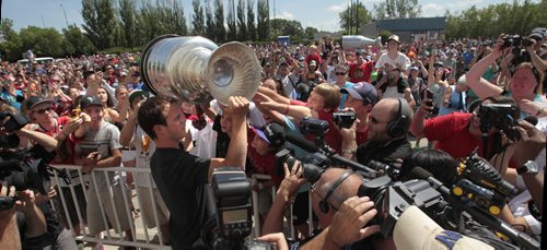 Chicago Blackhawks captain Jonathan Toews arrivies with the Stanley Cup for the hundreds of fans that attended the event at the Jonathan Toews Community Centre Friday afternoon. Randy Turner story Wayne Glowacki/Winnipeg Free Press July 19 2013
