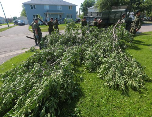 Brandon Sun Soldiers with the 1 Royal Canadian Horse Artillery work to remove the debris for the residences at CFB Shilo on Friday morning following a sever thunder storm that ripped through Westman on Thursday evening. (Bruce Bumstead/Brandon Sun)