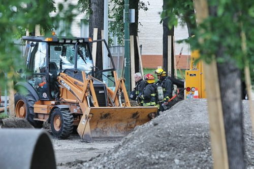 Emergency services crews work at the scene of a ruptured gas line in the 1000 block of Dominion Street. As a precaution some residences have been cleared of people and the public has been asked to avoid the area.  130723 July 23, 2013 Mike Deal / Winnipeg Free Press