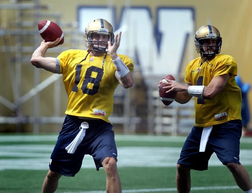 Justin Goltz unloads a pass at a team workout Friday. See Ed' story. Aug 2, 2013 - (Phil Hossack / Winnipeg Free Press)