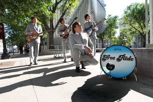 Members of the band Free Ride, a tribute band to the Beatles rehearse and pose for photos in market square. See Dave Sanderson story for upcoming McCartney show. Names of guys in band - Wayne Hlady (Ringo) - heavy set guy in front, Jerry Hlady  (John) with black guitar, Randy Moroz (Paul) - bass and Tom Pshednovak (George) - rear. August  03,, 2013 Ruth Bonneville Winnipeg Free Press