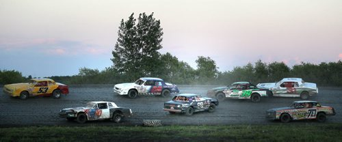 Dirt Track Racing....Day in the Life Shot Aug 1, 2013 Racers round the corner some more successfull than others on the slippery dirt track race night at Red River Co-op Speedway.....Aug 1, 2013 - (Phil Hossack / Winnipeg Free Press)