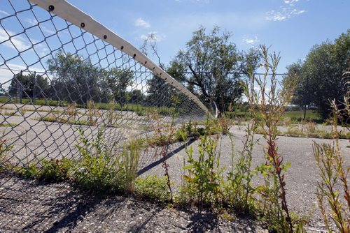 Tennis courts are in need of repair behind Margaret Grant Pool. BORIS MINKEVICH / WINNIPEG FREE PRESS. August 6, 2013