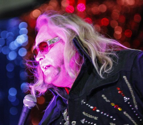 """Dave """"Blonde Elvis"""" Greene, who is also an organizer of the Gimli Elvis Festival, belts out a tune amid the lights and live music on Saturday, August 10, 2013. (JESSICA BURTNICK/WINNIPEG FREE PRESS)"""