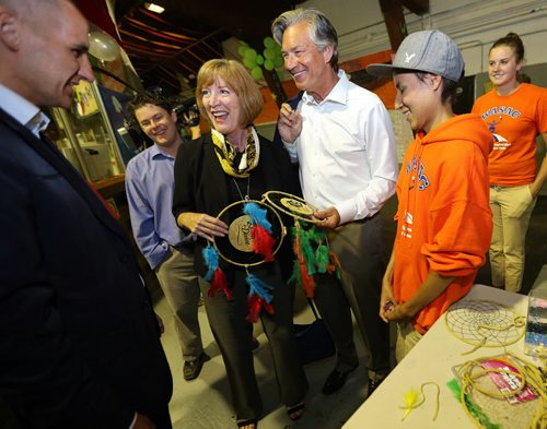 Canada's Ambassador to the US , Gary Doer and his wife Ginny Devine are happy to recieve Dreamcatchers  made by the children in the  summer camp-  Doer is are in town and visiting the WASAC kids camp at Old Exhibition Arena along with (far left)  MLA for Point Douglas  Kevin Chief and far right Sterling Muskego one of the kids at the camp -Chief also mentors Muskego -  Alex Paul story  KEN GIGLIOTTI / Aug 12 2013 / WINNIPEG FREE PRESS