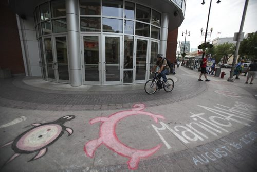 Chalk drawings outside of the MTS Centre advertise this weekend's Manito Ahbee aboriginal festival, which concludes tomorrow in the arena where the Aboriginal Peoples Choice Music Awards will be hosted. Saturday, August 17, 2013. (JESSICA BURTNICK/WINNIPEG FREE PRESS)