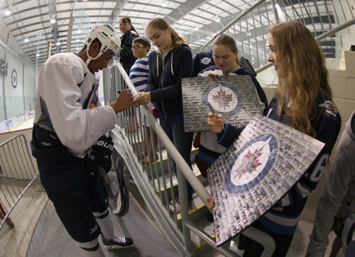 Winnipeg Jets Evander Kane stops to sign autographs after practicing with his team at the MTS Iceplex Tuesday-See Paul Wiecek and Gary Lawless stories- Sept 03, 2013   (JOE BRYKSA / WINNIPEG FREE PRESS)