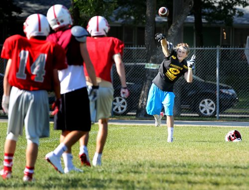 Kelvin's Varcity QB, Sebi Bel throws out a few passes Tuesday afternoon at a team workout. See Melissa Martin story......September 4, 2013 - (Phil Hossack / Winnipeg Free Press)