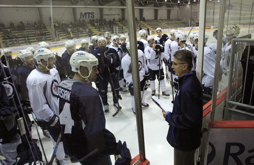 Sports. Head Coach Claude Noel speaks to players before scrimmage on the first day of Winnipeg Jets training camp held at the MTS Iceplex Thursday morning.  Ed Tait story Wayne Glowacki / Winnipeg Free Press Sept. 12 2013