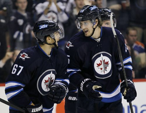 Winnipeg Jets' Mark Scheifele (55) and Michael Frolik (67) celebrate Frolik's goal against the Edmonton Oilers during second period pre-season NHL action in Winnipeg on Tuesday, September 17, 2013. (John Woods / WINNIPEG FREE PRESS)