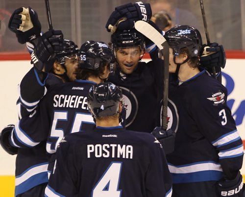 Winnipeg Jets Michael Frolik, left, is congratulated by teammates Eric Tagradi, centre-rear,Jacob Trouba, right-rear,Mark Scheifele, and Paul Postma after scoring  second period goal during play against the Edmonton Oilers during NHL pre-season action at the MTS Centre in Winnipeg Tuesday night -See Jets' stories- Sept 17, 2013   (JOE BRYKSA / WINNIPEG FREE PRESS)