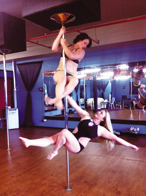 Canstar Community News Sept. 18, 2013 - Fantasy Pole Dancing instructors Tahea Mack (above) and Elisha Ewonchuk (below) celebrate the opening of their new location at 1032 Logan Ave. (second floor) on Sept. 14. The Pole Dance for Fitness Instruction Commission of Canada has rated the studio as one of the top three in the country, as well as Mack as one of the top five instructors. (SUPPLIED PHOTO COURTESY OF JOSH GRUMMETT)