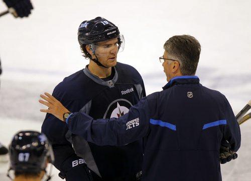 Winnipeg Jets practice at MTS Centre. BORIS MINKEVICH / WINNIPEG FREE PRESS. #19 Jim Slater talks to head coach Claude Noel. Sept. 20, 2013