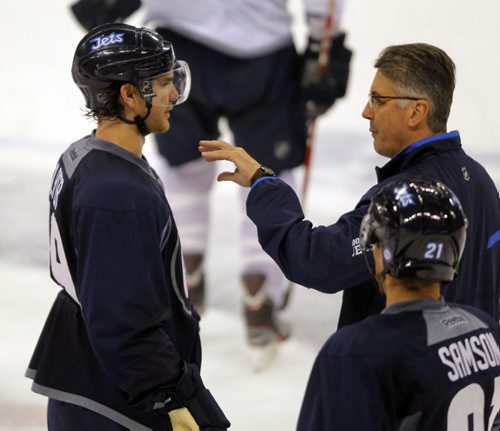 Winnipeg Jets practice at MTS Centre. BORIS MINKEVICH / WINNIPEG FREE PRESS. #19 Jim Slater talks to head coach Claude Noel. Sept. 20, 2013