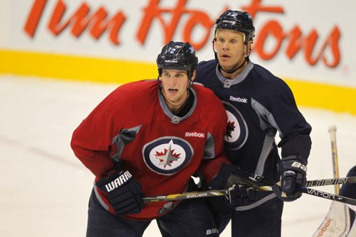 Winnipeg Jets practice at MTS Centre. #2 Adam Pardy and #12 Olli Jokinen. BORIS MINKEVICH / WINNIPEG FREE PRESS. Sept. 20, 2013