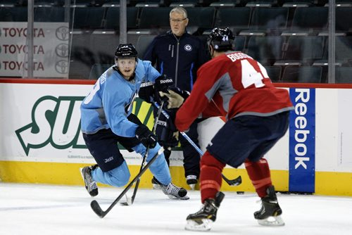 Training camp continues for the Winnipeg Jets Sunday morning, with Carl Klingberg (48) looking for someone to pass the puck to while bearing down on Zach Bogosian (44).  130922 - September 22, 2013 Mike Deal / Winnipeg Free Press