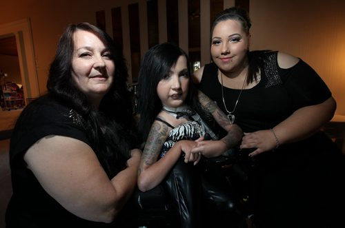 Cheryl Rondeau (left) and her daughters Crystal (center) and Cherisse this evening about their volunteer work for Muscular Dystrophy Canada.See story. September 24, 2013 - (Phil Hossack / Winnipeg Free Press)