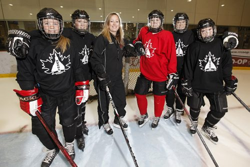 October 1, 2013 - 131001  -  Ashley van Aggelen (c), a physed teacher in St. James and the coach of the Winnipeg Avros AAA midget female team, is photographed with her captains (L to R) Nicole Reimer, Erin Kucheravy, Kelly Cockerill, Alanna Sharman, and Nicole Carswell at MTS Iceplex Tuesday, October 1, 2013. Van Aggelen is a former U of M Bisons player and former provincial under-18 coach who is considered a great female hockey role model at a time when there aren't many female head coaches. (John Woods / WINNIPEG FREE PRESS)