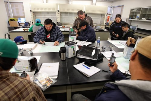 Eckart Buhlmann (centre) instructor and exploration geologist helps a student in the Exploration Technician Program at the Northern Manitoba Mining Academy in Flin Flon, MB. 130920 - September 20, 2013 MIKE DEAL / WINNIPEG FREE PRESS