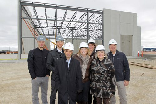 Bird Construction project manager Nathan Wiebe, Bird Construction District Manager Paul Bergman, Sindico Realty Inc. manager of industrial properties Robert Scaletta, CentrePort Canada Inc CEO Diane Gray, Rosser Ward 3 councillor Angela Emms, Rural Municipality of Rosser reeve Frances Smee, and Bird Construction Design Manager Richard Marshall pose for a photo in front of the partially constructed building. Davis Way and Mountain View Rd.To go with story on construction of mulit-use industrial building on the CentrePort grounds. BORIS MINKEVICH / WINNIPEG FREE PRESS Oct. 21, 2013