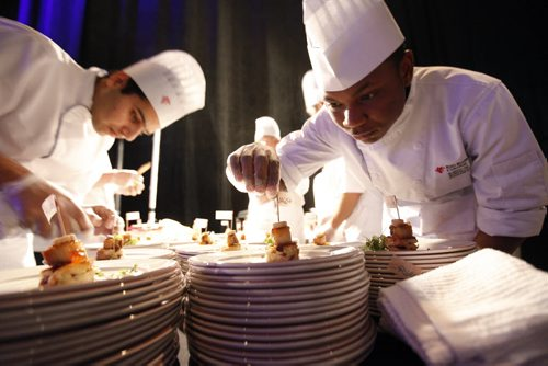 October 25, 2013 - 131025  -    A team works on an appetizer dish at Gold Medal Plates at the Convention Centre Friday, October 25, 2013. Gold Medal Plates is an annual competition that celebrates Canada's culinary stars while raising funds for the Canadian Olympic Foundation. Eight of Winnipeg's best chefs -- Timothy Palmer (The Velvet Glove), Eric Lee (Pizzeria Gusto), Kelly Cattani (Elements the Restaurant, by Diversity), Tristan Foucault (Peasant Cookery), Terry Gereta (Mise, Haute Prairie Cuisine), Simon Resch (Terrace in the Park), Michael Schafer (Sydney's at the Forks) and Jason Sopel (Chaise Restaurant & Lounge)-- will be competing John Woods / Winnipeg Free Press