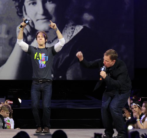 Co-founders Craig (left) and Marc Kielburger with a portrait of  Nellie McClung backdrop  at the WE DAY event in the MTS Centre Wednesday.  Wayne Glowacki / Winnipeg Free Press Oct. 30 2013