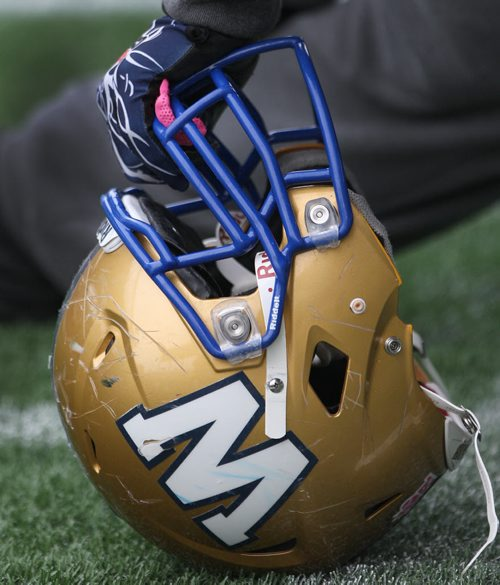 A Winnipeg Blue Bombers players sratched up helmet tells the story of the teams 2013 season- The team will play their final game of the 2013 season this Saturday against the Hamilton Tiger-Cats-  See Paul Wiecek story- Oct 31, 2013   (JOE BRYKSA / WINNIPEG FREE PRESS)