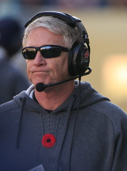 Bombers' head coach Tim Burke near the end of another Blue Bombers loss at Investors Group Field. Winnipeg Blue Bombers lost the final game of the season against the Hamilton Tiger Cats on Saturday. 131023 - Wednesday, October 23, 2013 - (Melissa Tait / Winnipeg Free Press)